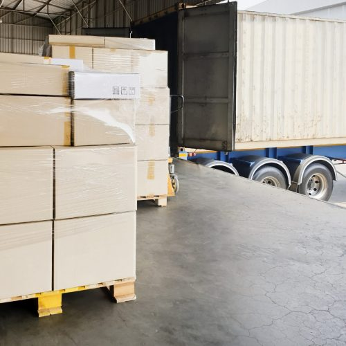 stack-shipment-boxes-pallet-waiting-load-into-container-truck-road-freight-shipment-transport-by-truck