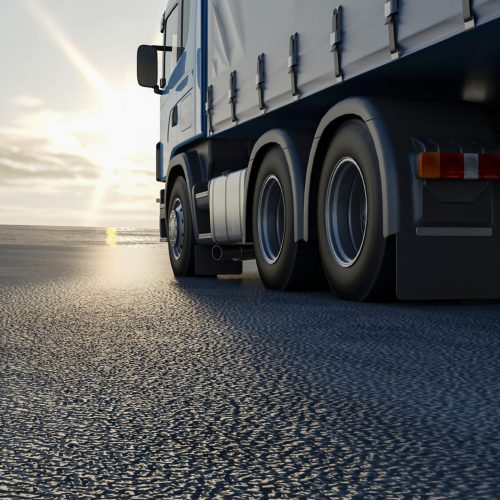truck-is-driving-along-road-3d-image-3d-rendering